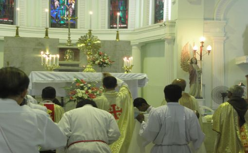 Incensing (blessing) the Eucharist in the Monstrance before the procession.