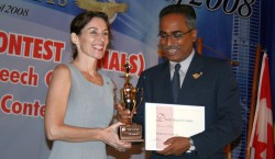 Marianna receiving a trophy for being champion speaker for Malaysia, Brunei and Indonesia 2 years ago.