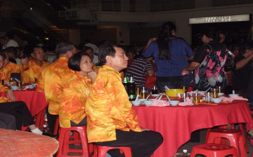 The committee members during the event were dressed in brightly orange coloured shirts.