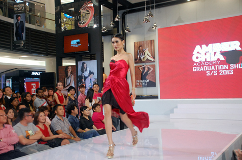 Amber Chia takes to the catwalk before she delivers her speech.