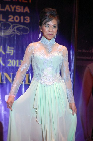Mrs Most Courageous  Jena Chuan at 60 in evening gown