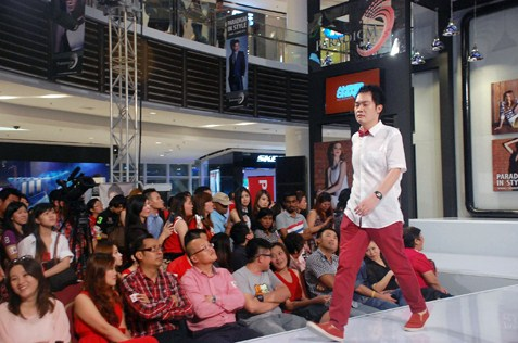 Ralph Tan on the catwalk among those who participated