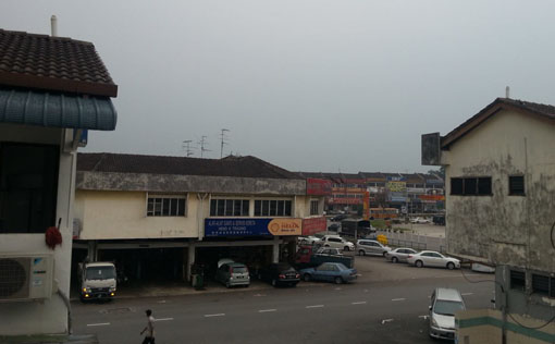 Taman Rosmerah, Johor Bahru. It's just started to drizzle. (04:00pm). Photo by Jez Tay.