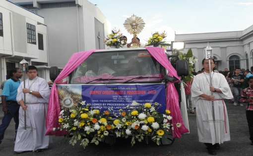 The Blessed Sacrament transfered to a deocrated lorry, ready for the procession.