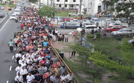The Faithful streaming out of the Assumption church for the 2km procession.