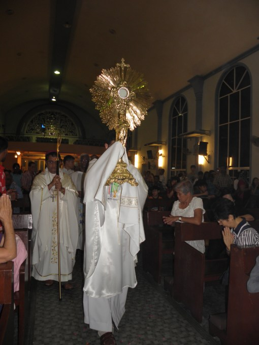 Carrying the Blessed Sacrament into the church for Benediction.