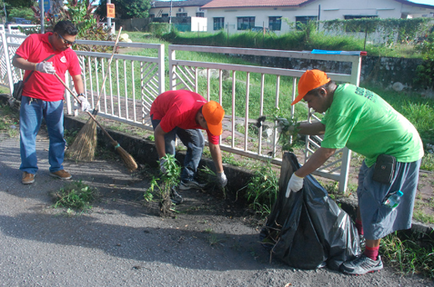 police (in red) and residents in gotong royong clean up section 20A RT