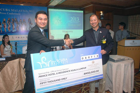 Prince Hotel director of sales Marcus Tioh present mock cheque to Robert Lo