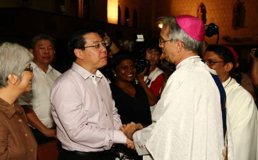 Archbishop Joseph Marino greeting the Penang CM