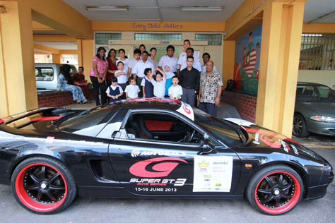 Super GT500 car in front of SAMH