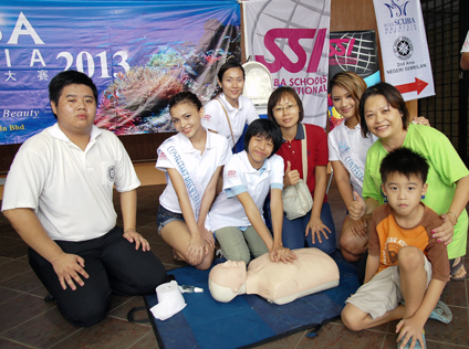 a CPR hands-on session using plastic dummies conducted by a CPR Team from