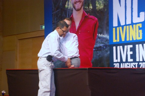 Nick Vujicic is lifted on the stage for his talk