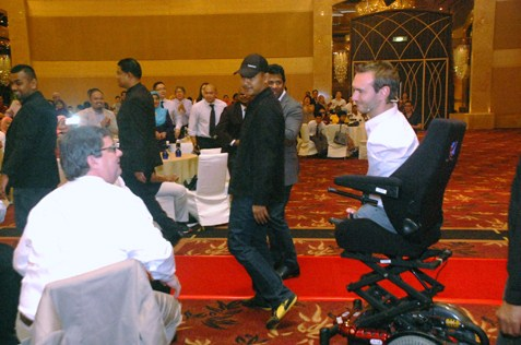 Nick Vujicic moves on his customised electric wheelchair.