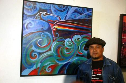 Hamidon Ahmed with his painting Awan Larat di Kuala Tumpat