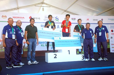 KL Marathon 2013 Malaysia Men category winners Fabian @ Osmond Bin Daimor (1), Shaharudin Bin Hashim (2) and Lim Kien Mau (3)