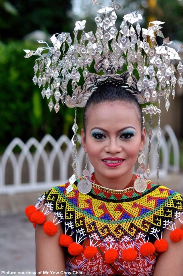 Pretty Iban girl in her traditional costume