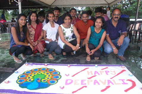 Annan Periyasamy (far right) and family members posing with their kolam