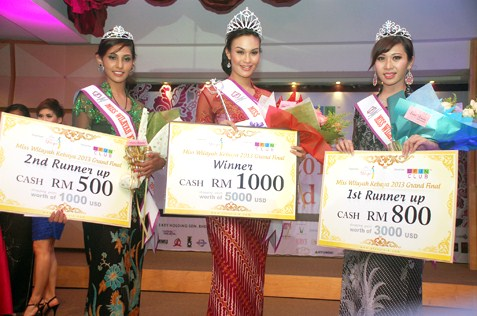 Miss Wilayah Kebaya 2013 winner Sunshine Aileen Devi Eric (centre), 1st runner-up Nasha Afra Zaidi (right) and 2nd runner-up Leanndrea Anne Paramaraj (left).