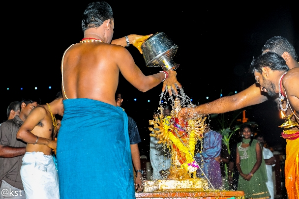 Lord Durga being cleansed after the fiery battle with the Demon Mahishasura