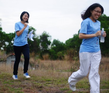 Two participants running past the graveyards