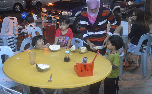 A young family enjoying the durians