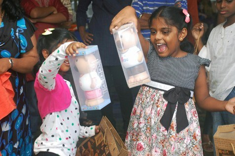 excited children with their winning prizes