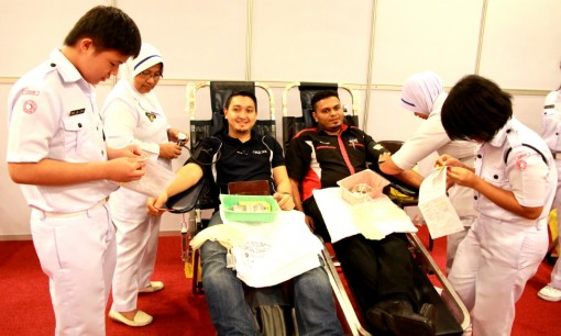 Two young men bravely donating their blood