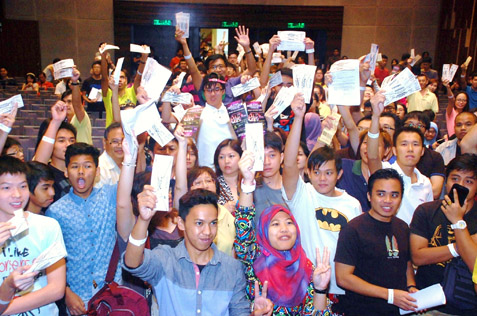 Angry K-pop fans waving their tickets to demand their money back for cancelled concert during a briefing by concert organiser Marctensia.