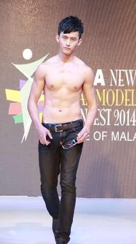 Asia New Star Model 2014 FOM male winner Josh Yen shows off his muscular frame