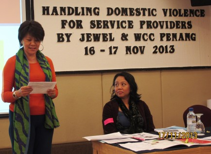 JEWEL's member Evelyn Nabila introducing Melissa Akhir, the legal officer of WCC