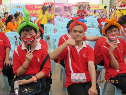 Some of the 15 residents of the Johor Cheshire Home playing with laughter masks