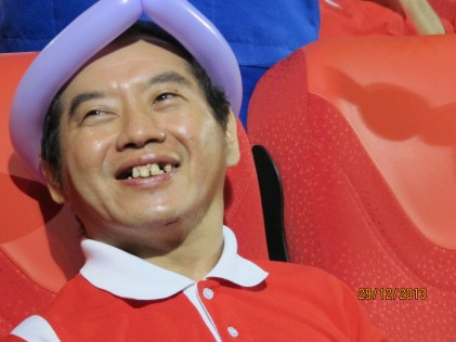 Mr Ang Choo Sien is smiling to the camera