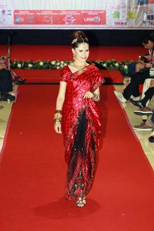 Massuhaella walks the runway in red hot saree