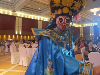 The Chinese mask changing artiste captivating  the audience