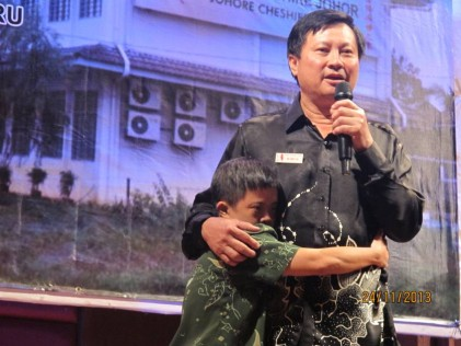 A 38-year old resident clings to Dr Ng when he speaks passionately about the Home