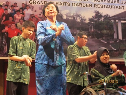 Madam Chong leading the Gangam dance with the residents