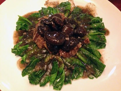 Braised taukan with mushroom in black moss sauce