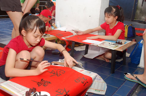 Children participating in calligraphy contest