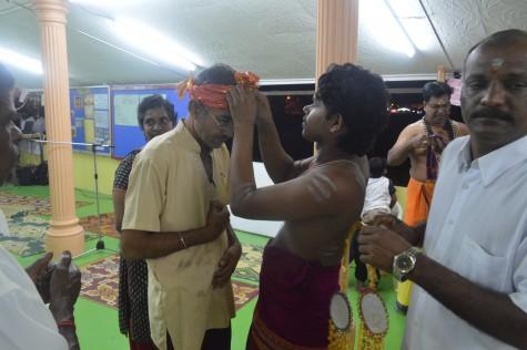 Inderjit receving the head scraf