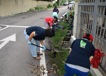 Residents cleaning up the area together