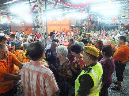 Senior citizens receiving food packages at Cheras Flats Charity Night