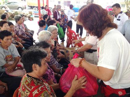Senior citizens receiving foodstuff