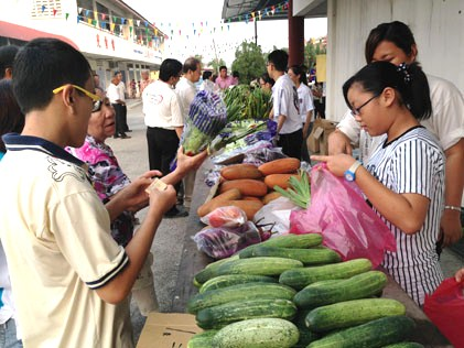 Carnival stall selling fresh vegetables from Cameron Highlands