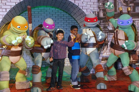Children from Shelter Home, PJ posing with Teenage Mutant Ninja Turtles @ the Curve