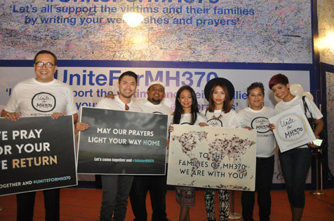 (L-R) Dato' Latt Shariman Abdullah, Dennis Lau, Russell Curtis, Atilia, Hunny Madu, Elvira Arul and Jaclyn Victor at #UniteforMH370 vigil held at the Curve.