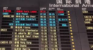 The information board indicating that flight MH370 of Malaysia Airlines is delayed