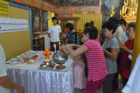 The offering of rice into the alms bowl ceremony
