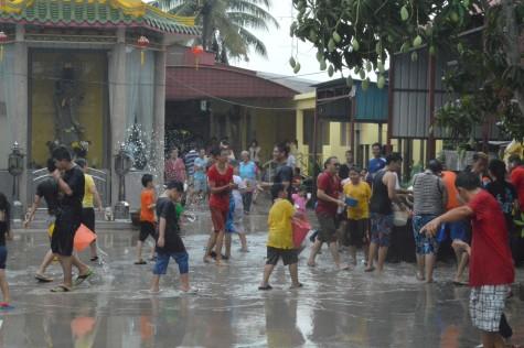 Devotees having fun splashing water at each other
