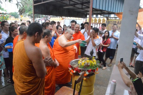 Monks sprinkling onto the Lord Buddha statue