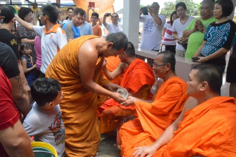 Monks join the fun as well, as they sprinkle water on each other